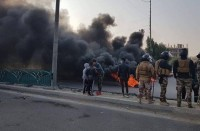 مقتل-متظاهرين-بالعراق..-وشلل-شبه-تام-بالوسط-والجنوب-