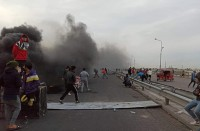 مجهولون-يحرقون-خياما-للمعتصمين-في-بغداد-والناصرية